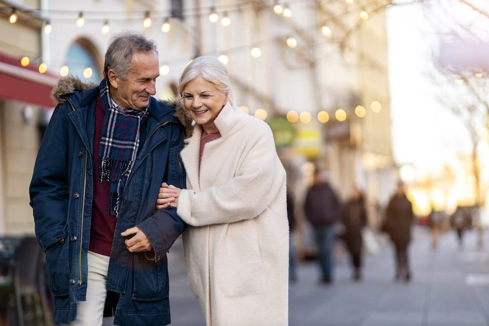 mature couple christmas shopping | Hear More Associates